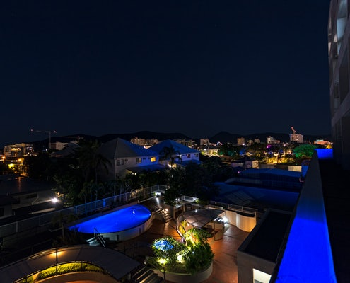 alternative night view overlooking the pool at the sunshine tower hotel